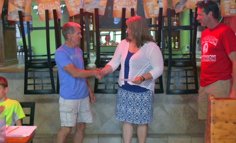 Foundation Board member Lori Smith accepts check from CRC